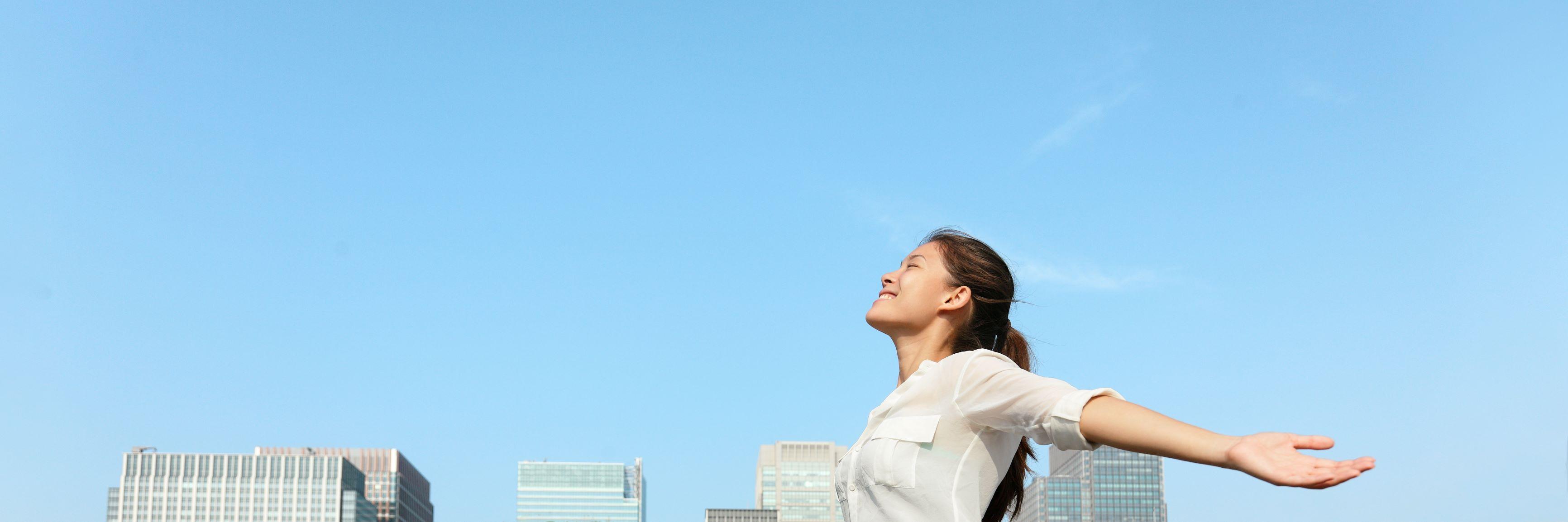 photo of blue skies, buildings woman